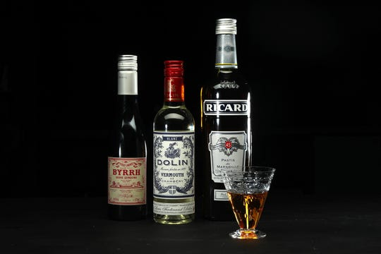French aperitifs, left to right, Byrrh Grand Quinquina, Dolin Blanc Vermouth de Chambery and Ricard Pastis de Marseille (also seen in the glass) shown on Tuesday, April 16, 2019. (Terrence Antonio James/Chicago Tribune/TNS