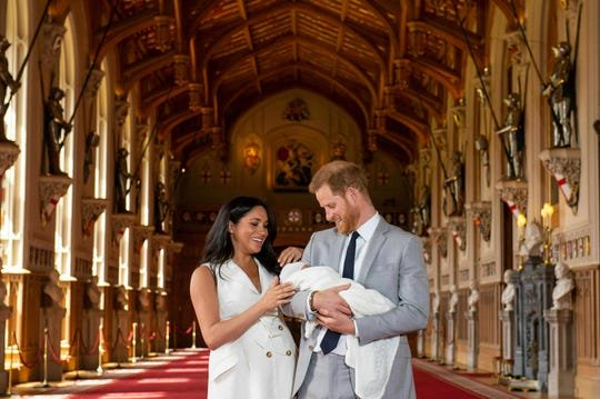 Britain's Prince Harry and Meghan, Duchess of Sussex, show off their newborn son in St George's Hall at Windsor Castle, Windsor, south England, Wednesday, May 8, 2019.