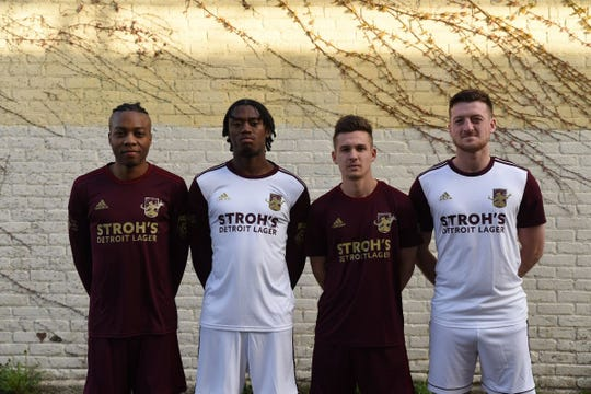 From left, Shawn Lawson, Omar Sinclair, Bakie Goodman and Stephen Carroll wear the 2019 home (maroon) and away (white) Detroit City FC uniforms, which were unveiled Tuesday.