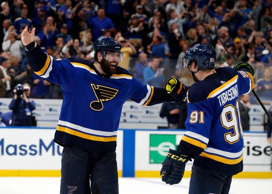 Blues left wing Pat Maroon, left, and right wing Vladimir Tarasenko celebrate the team's 2-1 win against the Dallas Stars in Game 7 on Tuesday.