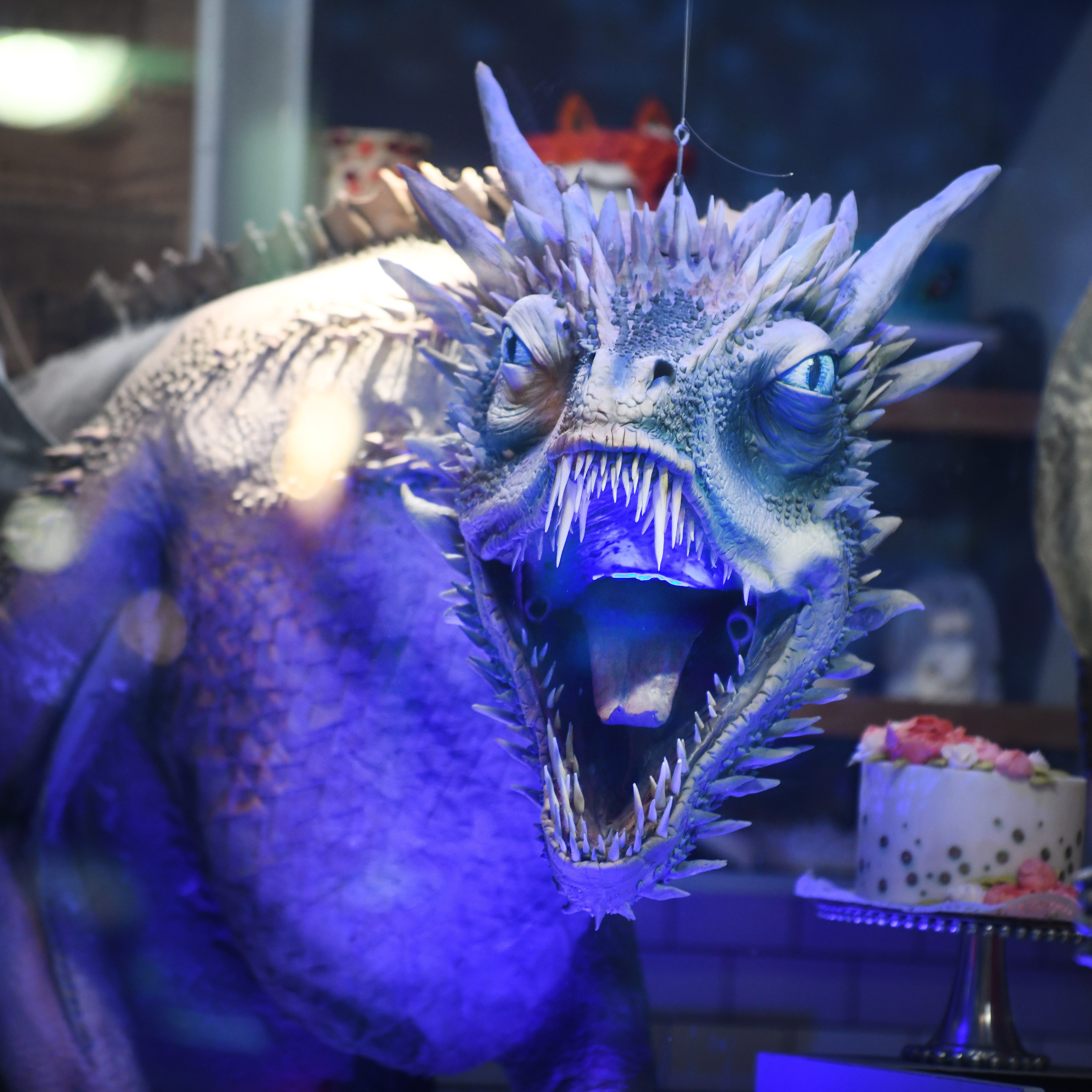 The dragon Viserion, turned into an ice dragon by the Night King, turns his terrifying face toward passersby from the window of The Home Bakery.