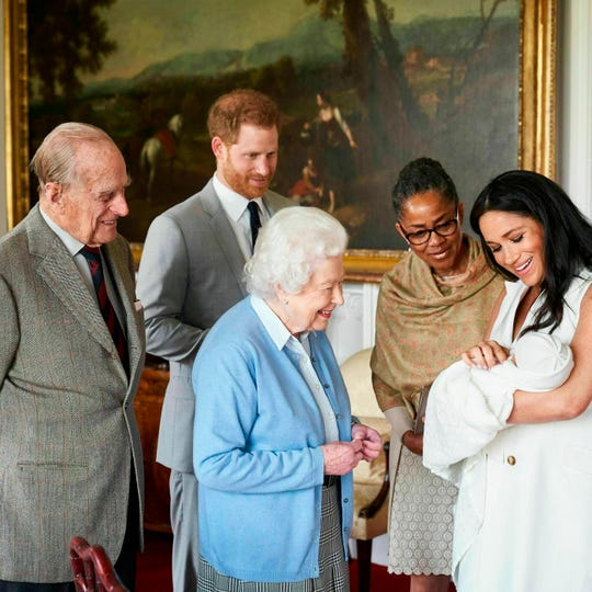 Britain's Prince Harry and Meghan, Duchess of Sussex, joined by her mother Doria Ragland, show their new son to Queen Elizabeth II and Prince Philip at Windsor Castle, Windsor, England.