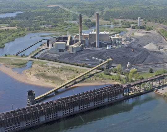 State regulators approved a utility's plan to build two natural gas-fueled power plants at the site of the coal-fired Presque Isle Power Plant, which was shut down in March.
