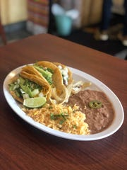 A plate of tacos with beans and rice at Jose's Tacos at 218 E. Grand River in Detroit.