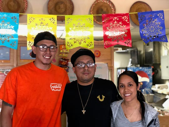 Luis Orozco, center, with his sister Laura Orozco-Martinez and her husband Ricardo Martinez.