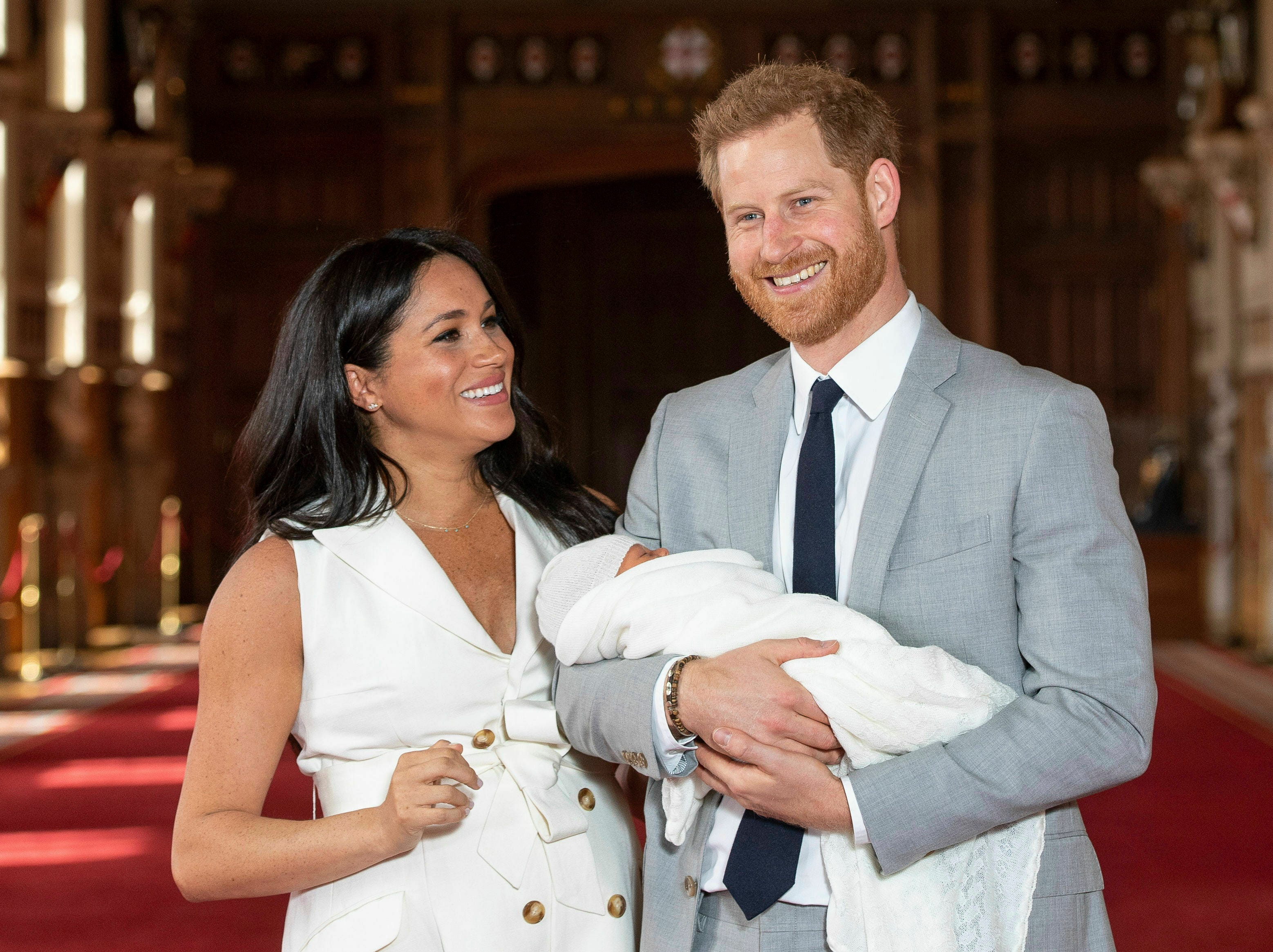 Britain's Prince Harry and Meghan, duchess of Sussex, during a photocall with their newborn son in St. George's Hall at Windsor Castle, Windsor, south England, Wednesday May 8, 2019. Baby Sussex was born Monday at 5:26 a.m.