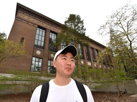 "University of Michigan student Derek Suo, of West Bloomfield Township, said his parents are funding his degree. Unlike so many debt-ridden students, ""I'm thankful I won't have to worry about that when I graduate."""