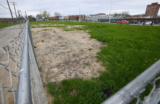 The Ilitch organization owns some vacant land across the street from the Tumaini Center, on Third near MLK Jr. Blvd., about six blocks northwest from Little Caesars Arena.