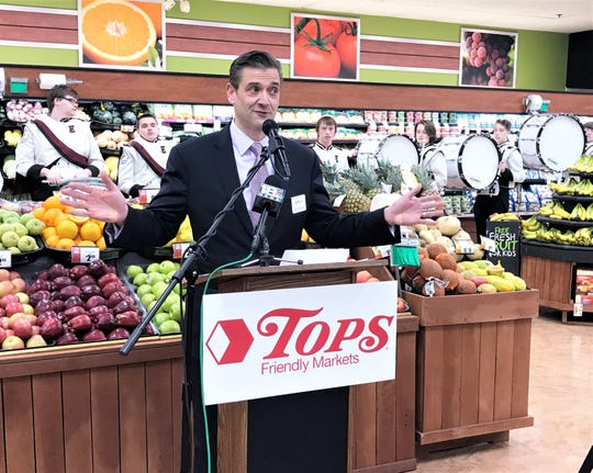 John Persons, president and CEO of Tops Friendly Markets, talks about a $1.8 million upgrade at the Southport Tops location during a grand re-opening celebration Wednesday.