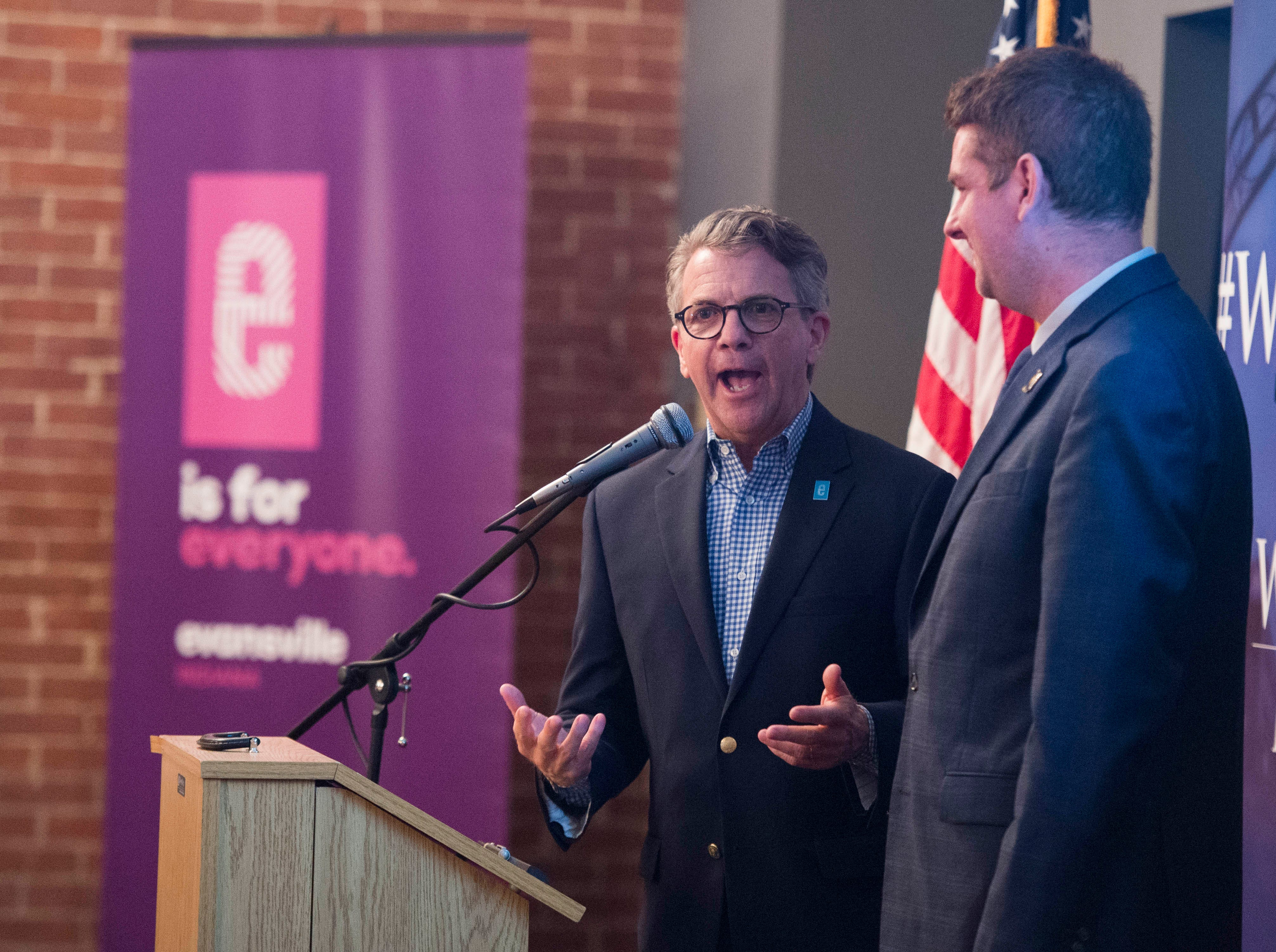 """Evansville Mayor Lloyd Winnecke (R), left, sings """"Happy Birthday"""" to city council at-large candidate Zane Clodfelter (R) during the Vanderburgh County Republican Party's watch party at Sauced! restaurant on Haynie's Corner Tuesday, May 7, 2019. Clodfelter turned 29 years old Tuesday."""