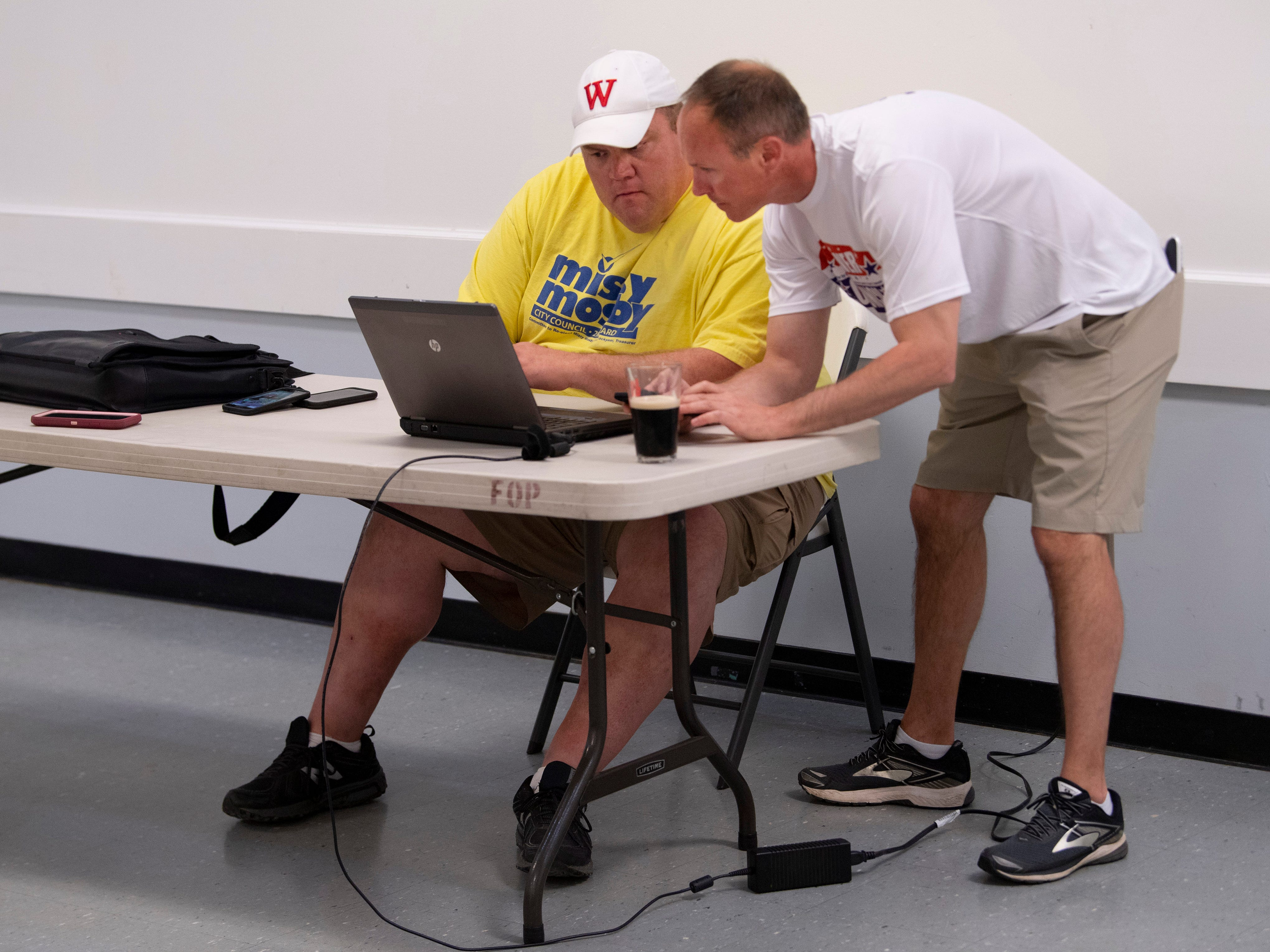 City Council member Jonathan Weaver (D), right, and campaign volunteer Chris Cooke wait for results from Evansville's primary election at the Fraternal Order of Police Tuesday night. Weaver was one of three Democrats to win their races to compete against the Republicans for the at-large seat in the fall general election.