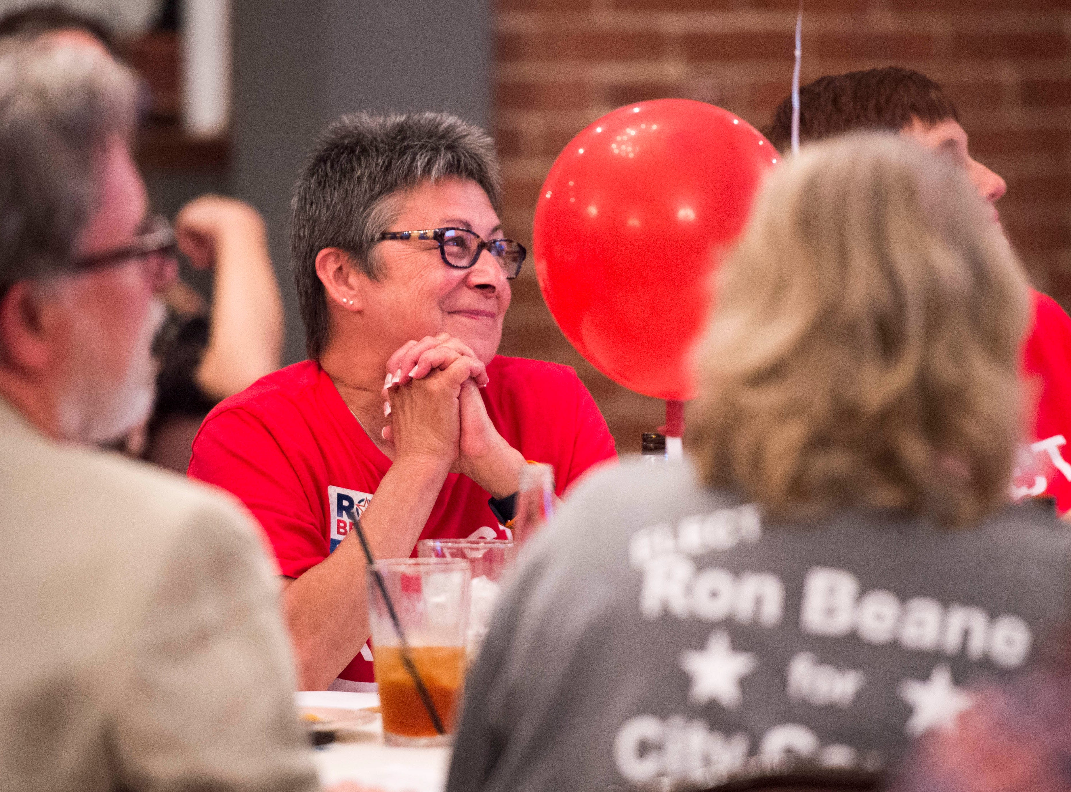 Kim Beane smiles as her husband city council at-large candidate Ron Beane (R) thanks her while addressing the crowd during the Vanderburgh County Republican Party's watch party at Sauced! restaurant on Haynie's Corner Tuesday, May 7, 2019.