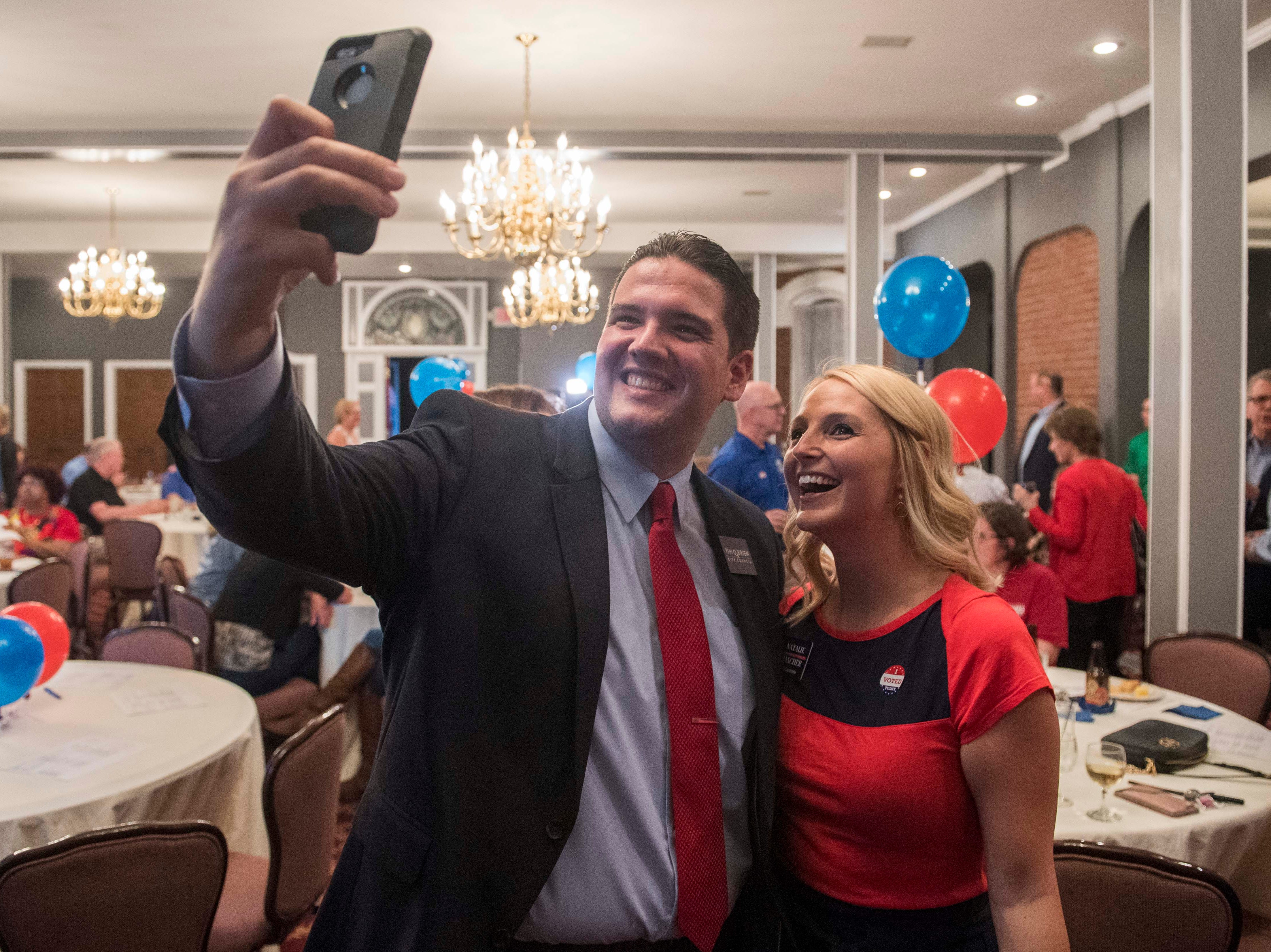 Republican candidates Tim O'Brien and Natalie Rascher take a photo together the Vanderburgh County Republican watch party Tuesday, May 7, 2019.