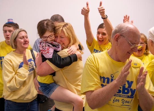 City Council member Missy Mosby (D) celebrates with her niece, Laura Diekmann, 11, and the rest of her family after the final results from the Evansville primary election were posted at the Fraternal Order of Police Tuesday night. Mosby won the 2nd Ward contest and will face Republican Natalie Rascher in the fall general election.