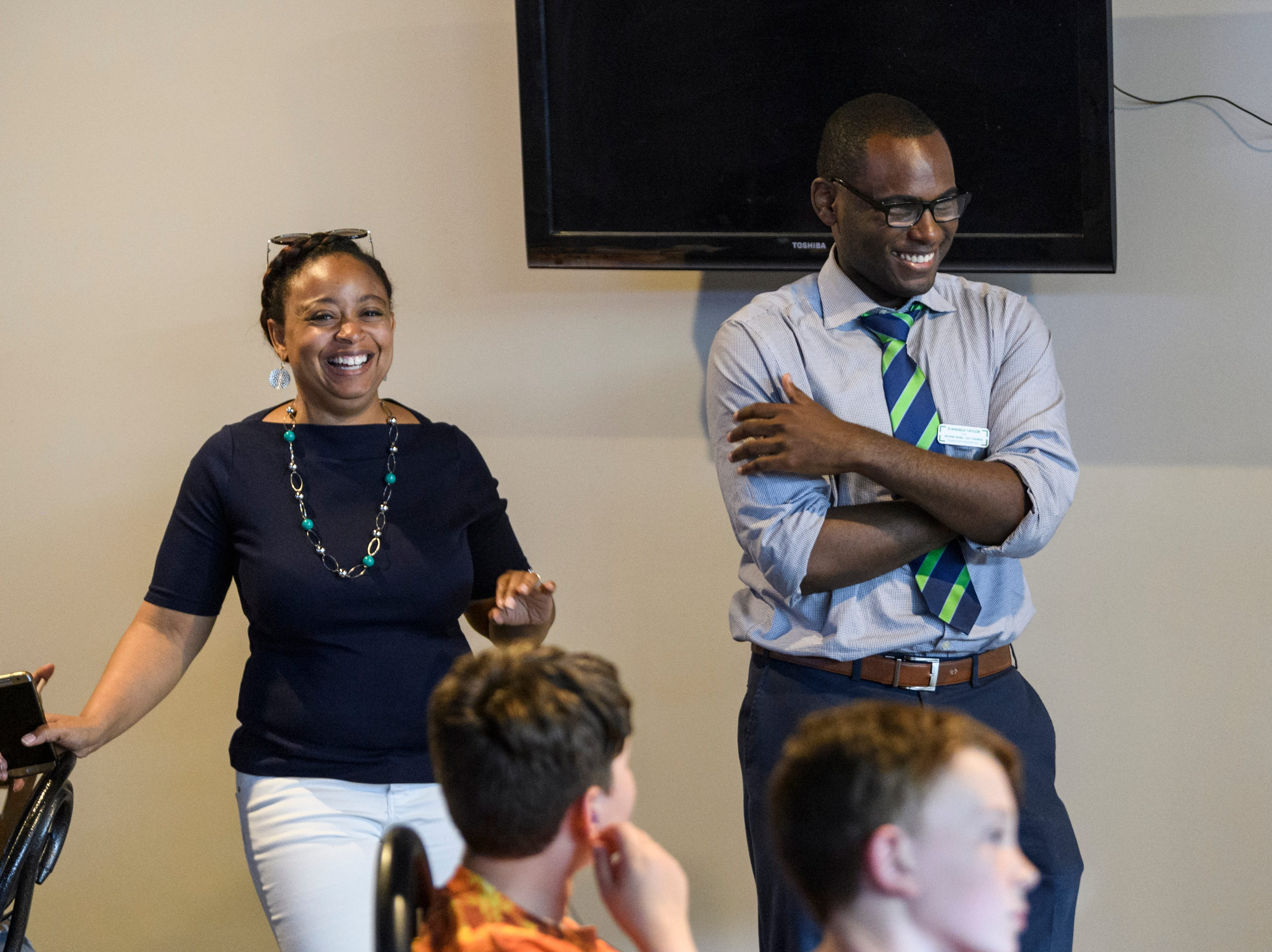 D'Angelo Taylor, right, and his campaign manager Karese Johnson, left, laugh as several supporters stand up to talk about Taylor's impact on the community despite his loss to Missy Mosby in the second ward city council race during a watch party at Spudz-N-Stuff on Washington Avenue in Evansville, Ind., Tuesday, May 7, 2019.
