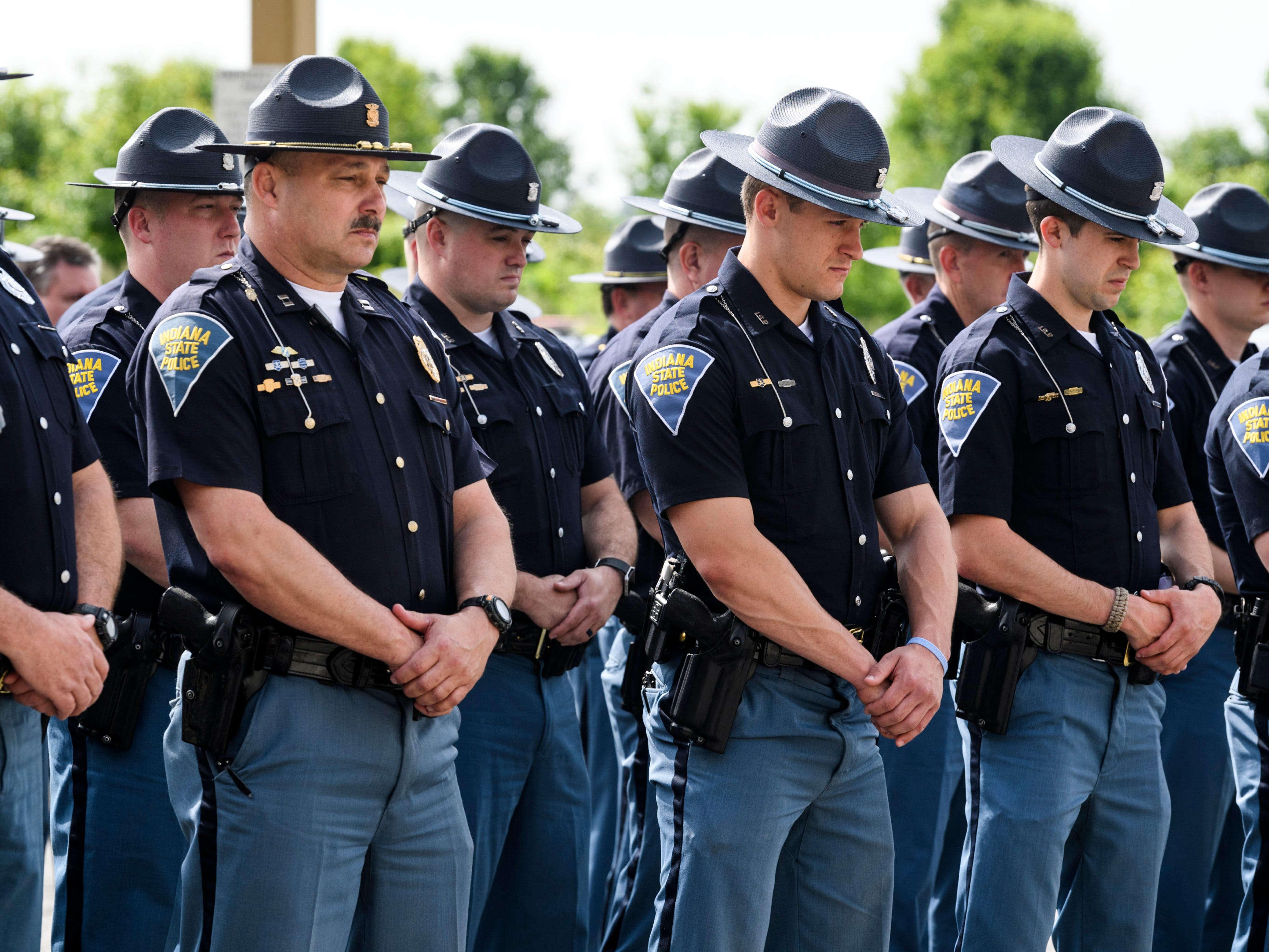 "Indiana State Police Troopers listen as the names of all 46 ISP members who have died in the line of duty are read aloud including a brief description of the circumstance of death during the annual ISP memorial service at the Evansville District Police Post, Wednesday morning, May 8, 2019. ""Thankfully we haven't lost anyone from the state police in a number of years,"" Sgt. Todd Ringle, ISP Public Information Officer, said. ""[The annual memorial] serves as a grim reminder that our job is very dangerous."""