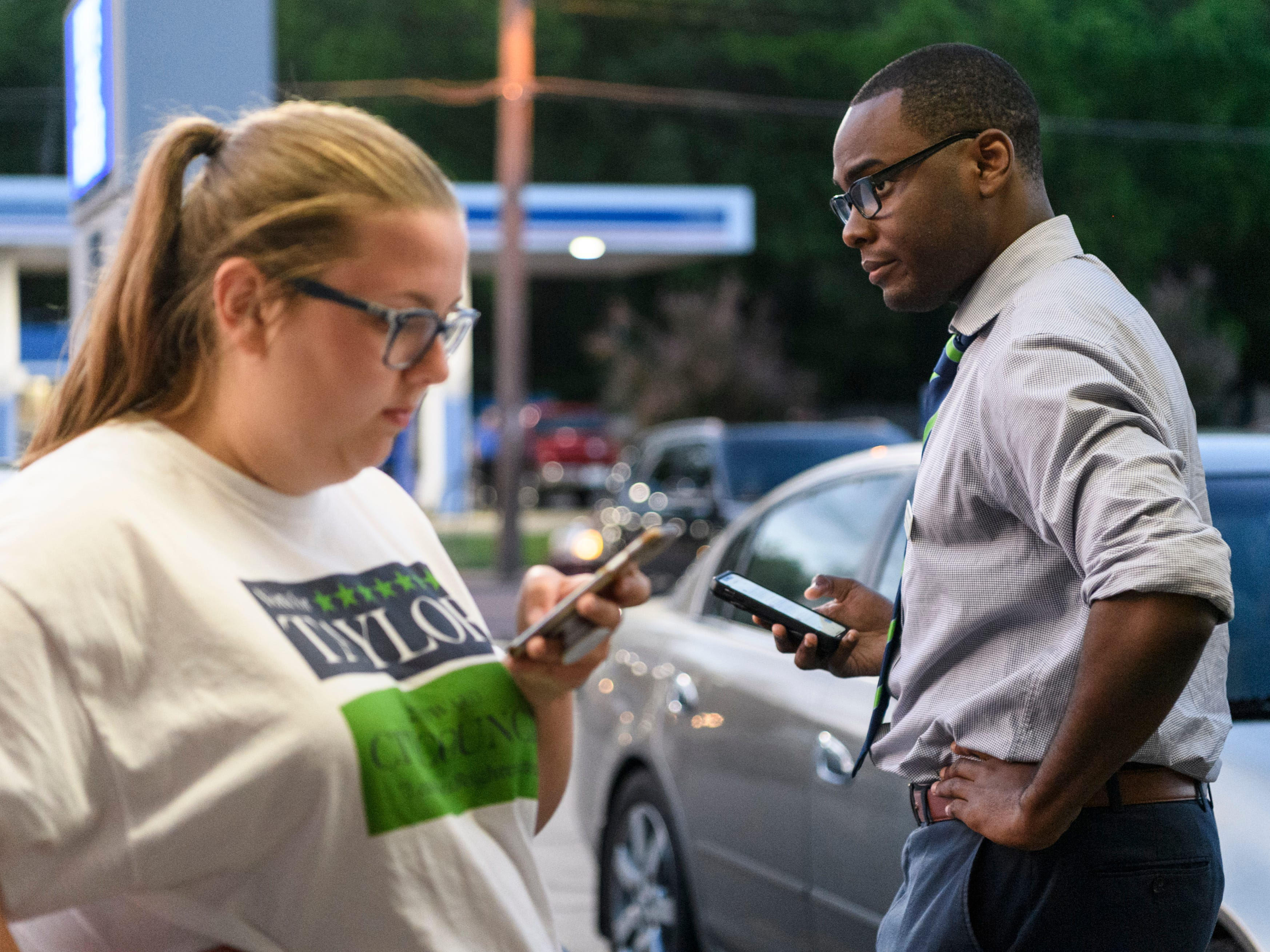 Anna Ardelean, left, and D'Angelo Taylor, right, check for an update on election results for his second ward city council primary race against incumbent Missy Mosby at Spudz-N-Stuff in Evansville, Ind., Tuesday, May 7, 2019. Ardelean, a student studying political science at the University of Southern Indiana, worked as Taylor's campaign field director.