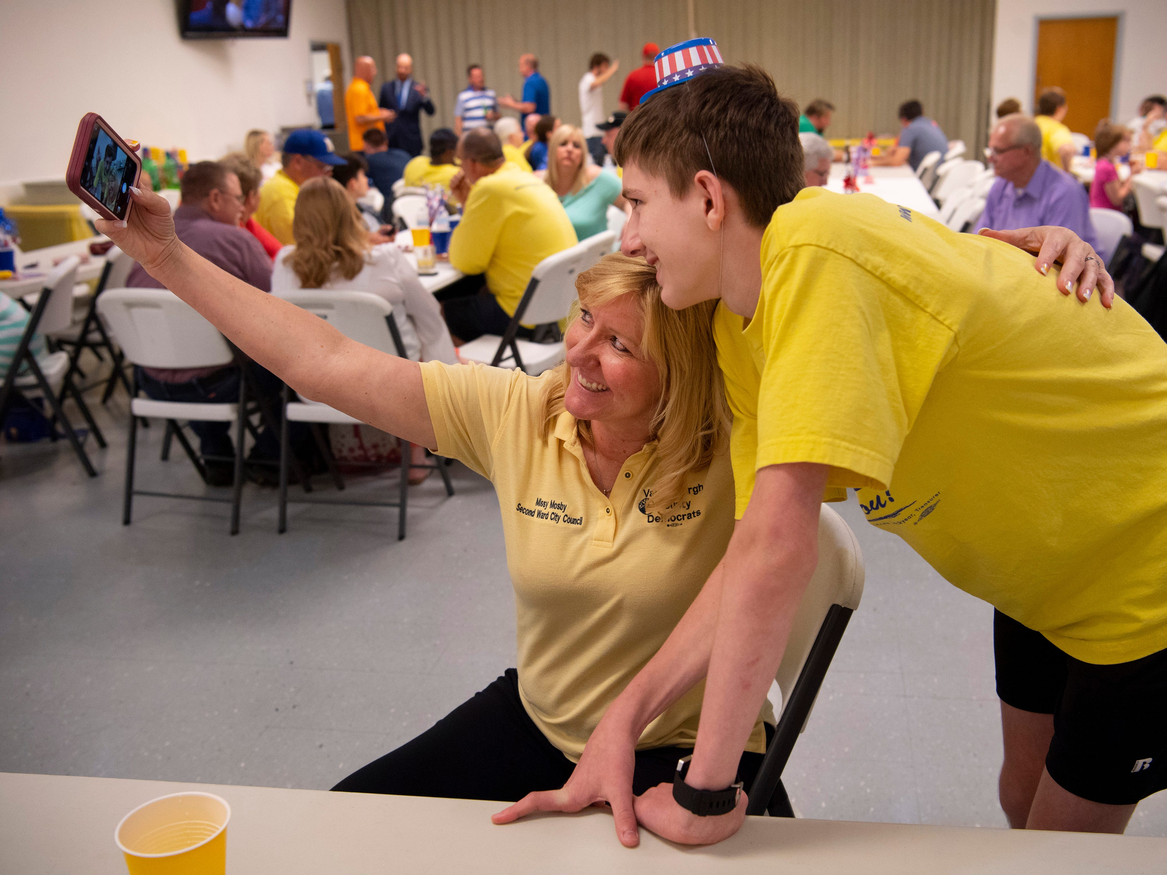 City Council member Missy Mosby (D) takes a selfie with nephew Caleb Diekmann, 15, as they wait for the latest vote tally from the Evansville primary election at the Fraternal Order of Police Tuesday night. Mosby won the 2nd Ward contest and will face Republican Natalie Rascher in the fall general election.