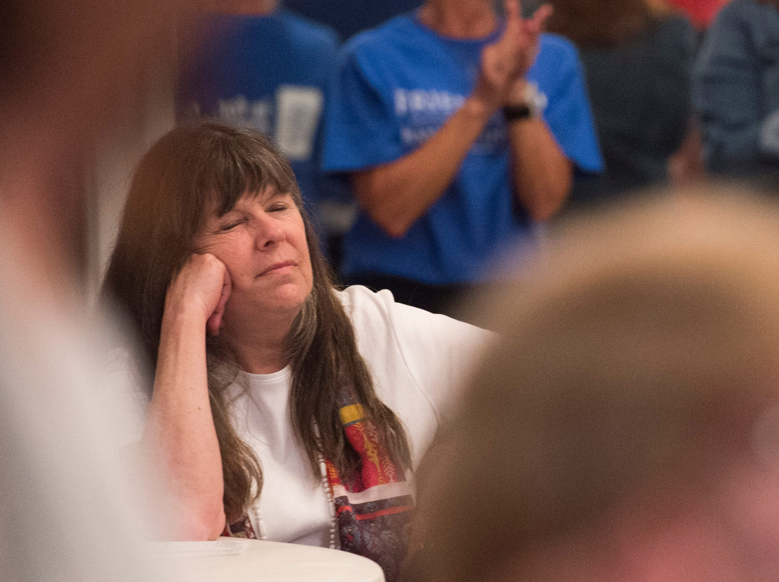 Mayoral candidate Connie Whitman closes her eyes as the crowd cheers for primary winner Mayor Lloyd Winnecke Tuesday, May 7, 2019.