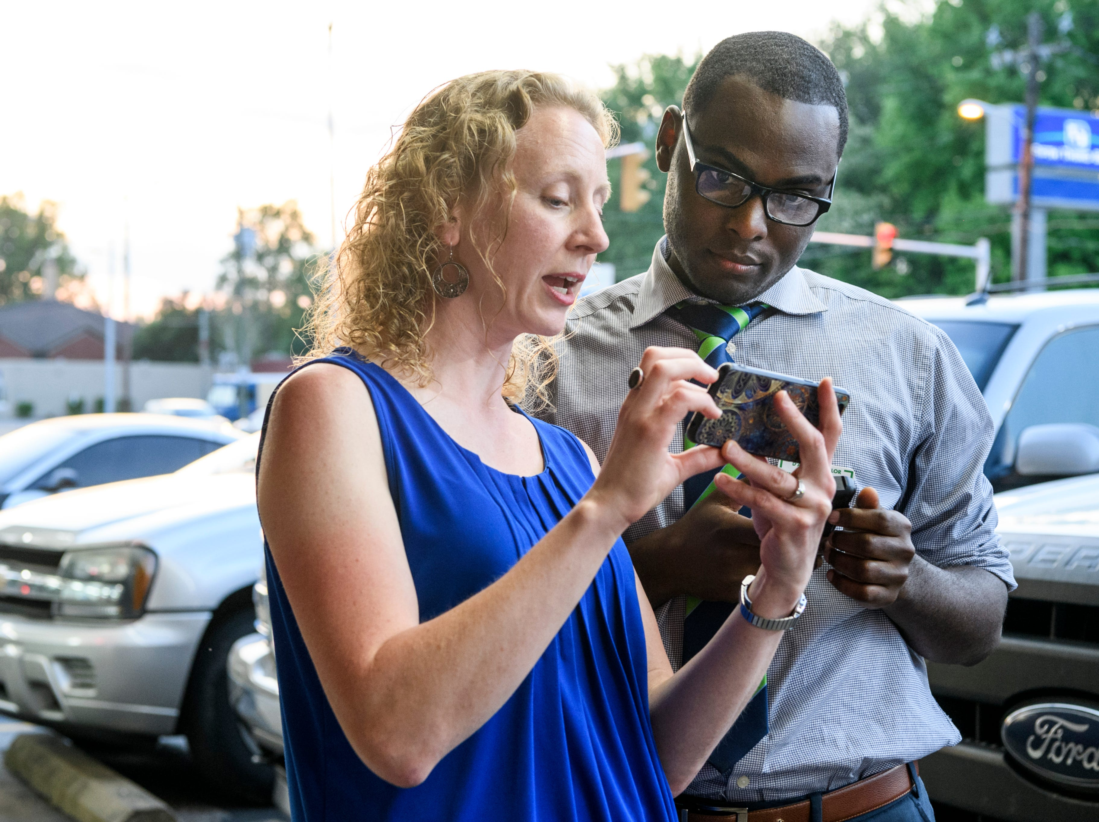 Gina Robinson Ungar, left, and D'Angelo Taylor, right, look over incoming election results during a democratic election watch party at Spudz-N-Stuff on Washington Avenue in Evansville, Ind., Tuesday, May 7, 2019. Robinson Ungar won one of three democratic at-large city council spots and Taylor lost a contentious second ward city council race to Missy Mosby (not pictured).