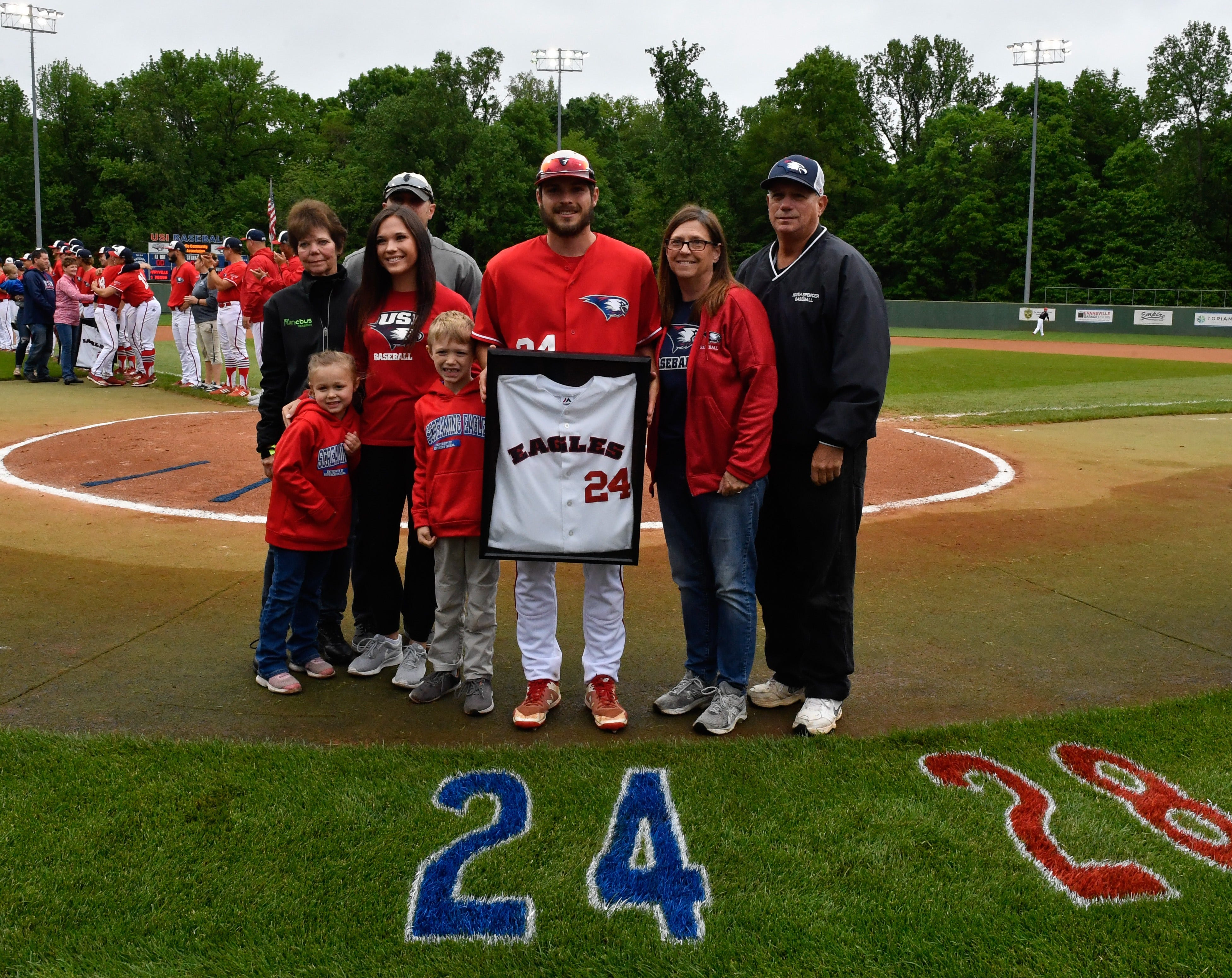 The Kuester family stands alongside Nathan during USI Senior Day ceremony.