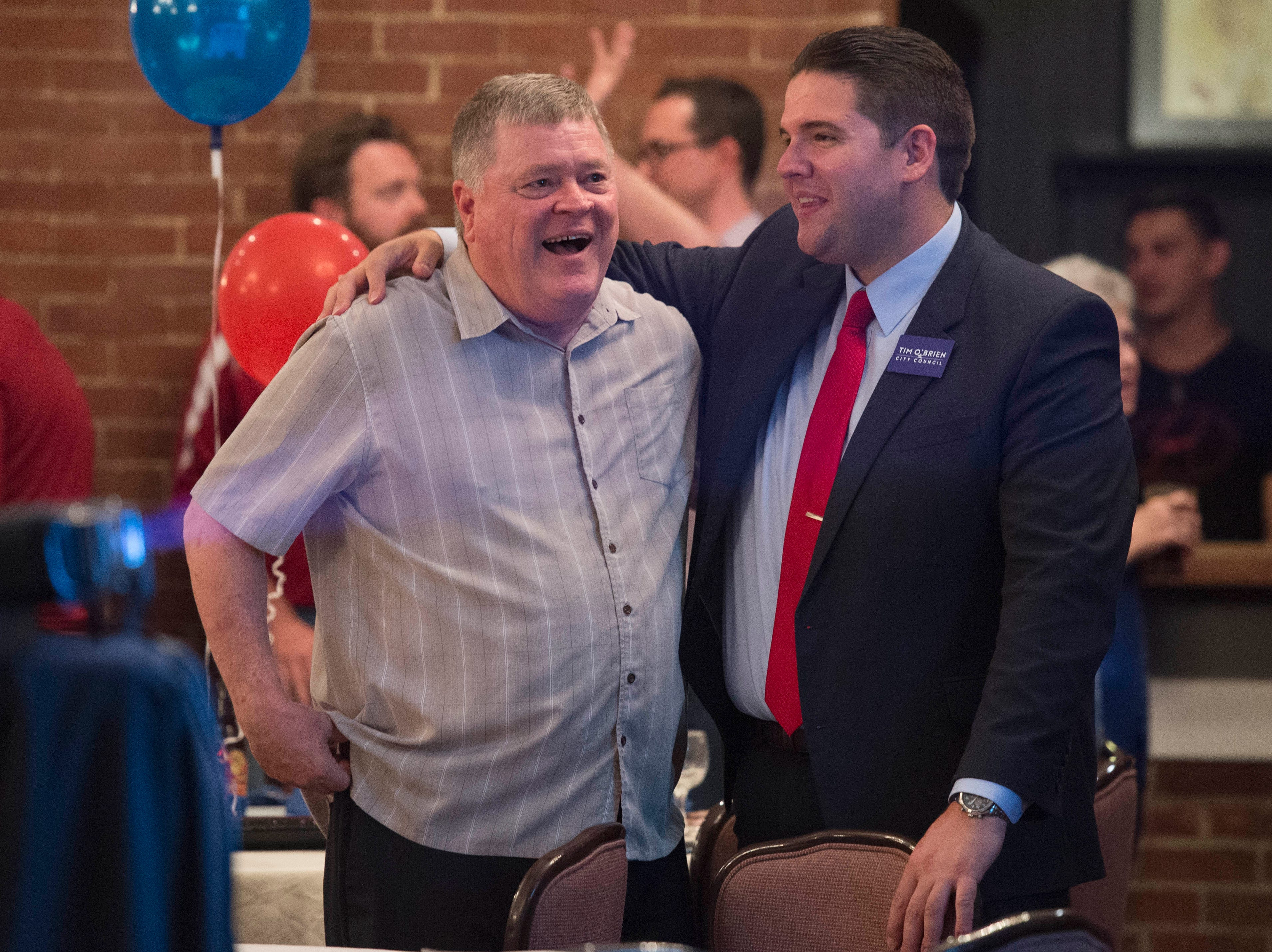 Republican candidates Ron Beane, left, and Tim O'Brien, right, congratulate each other as the primary results come in Tuesday, May 7, 2019.