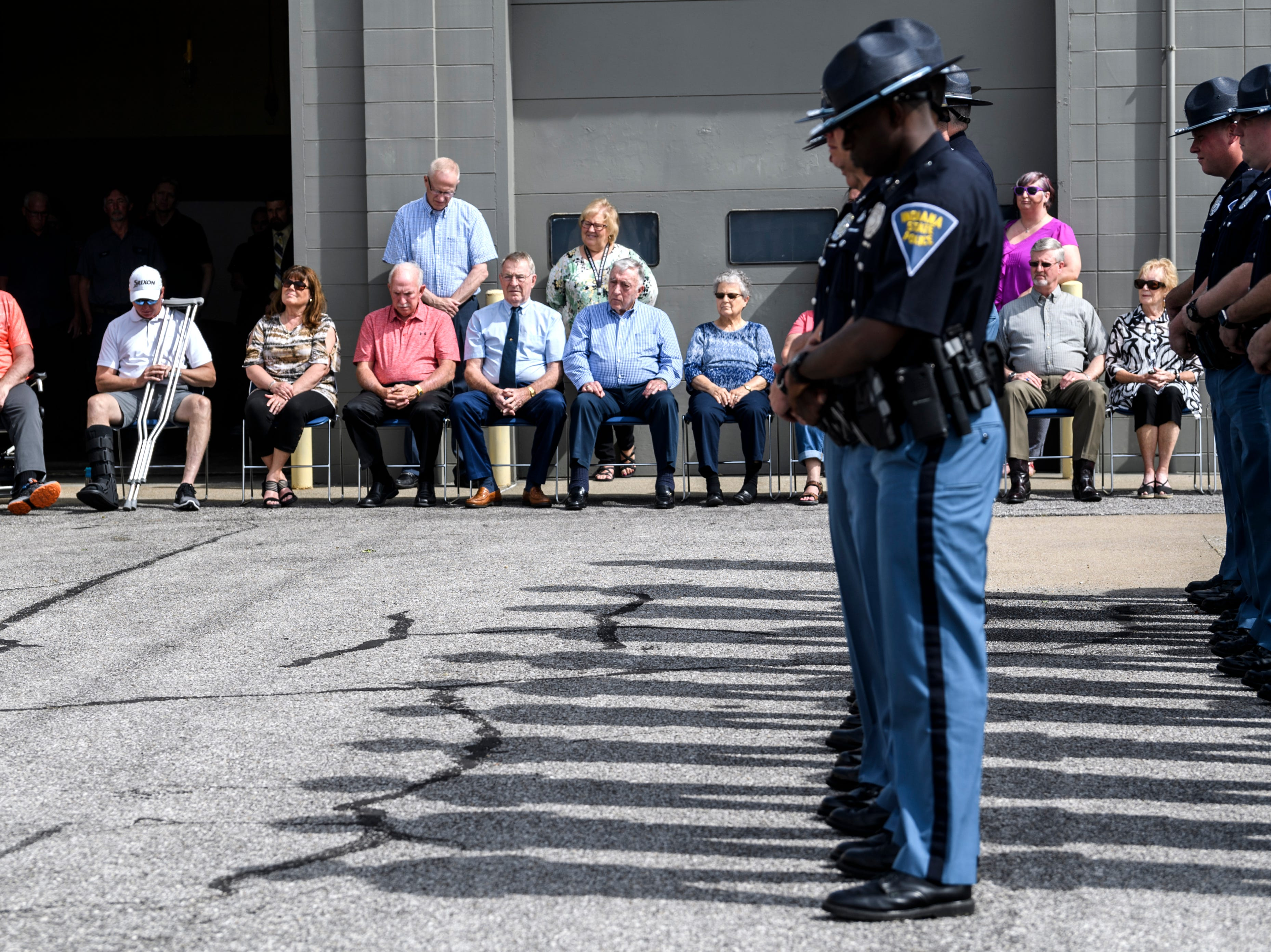 Community members and Indiana State Police Troopers listen to names of 46 ISP officers who have died in the line of duty since 1933 during an annual memorial service at the Indiana State Police Post in Evansville, Ind., Wednesday, May 8, 2019.