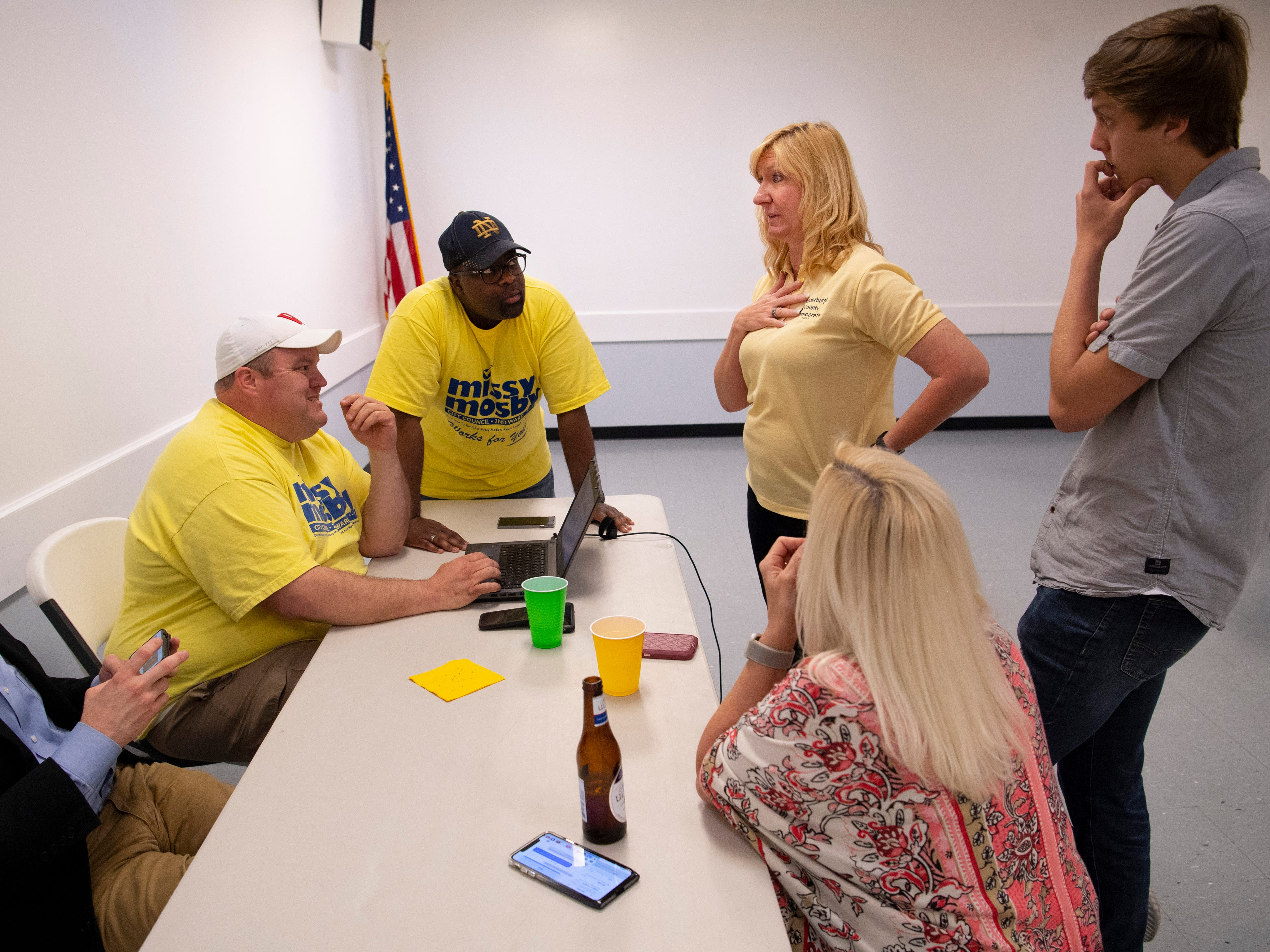 City Council member Missy Mosby (D), second right, awaits the latest vote tally from the Evansville primary election at the Fraternal Order of Police Tuesday night. Mosby won the 2nd Ward contest and will face Republican Natalie Rascher in the fall general election.