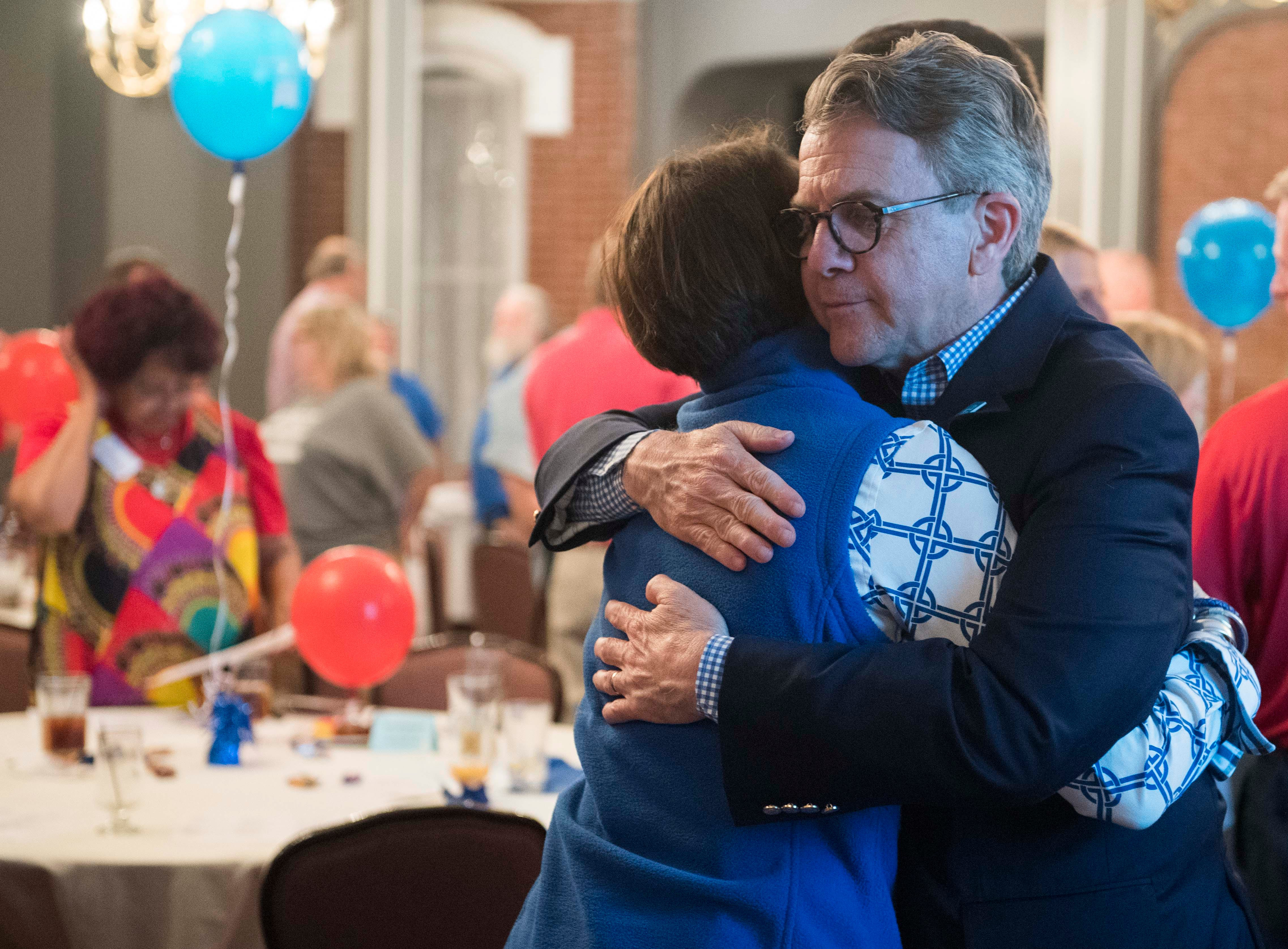Evansville Mayor Lloyd Winnecke (R) hugs his wife Carol McClintock after Winnecke wins the primary election for mayor Tuesday, May 7, 2019.