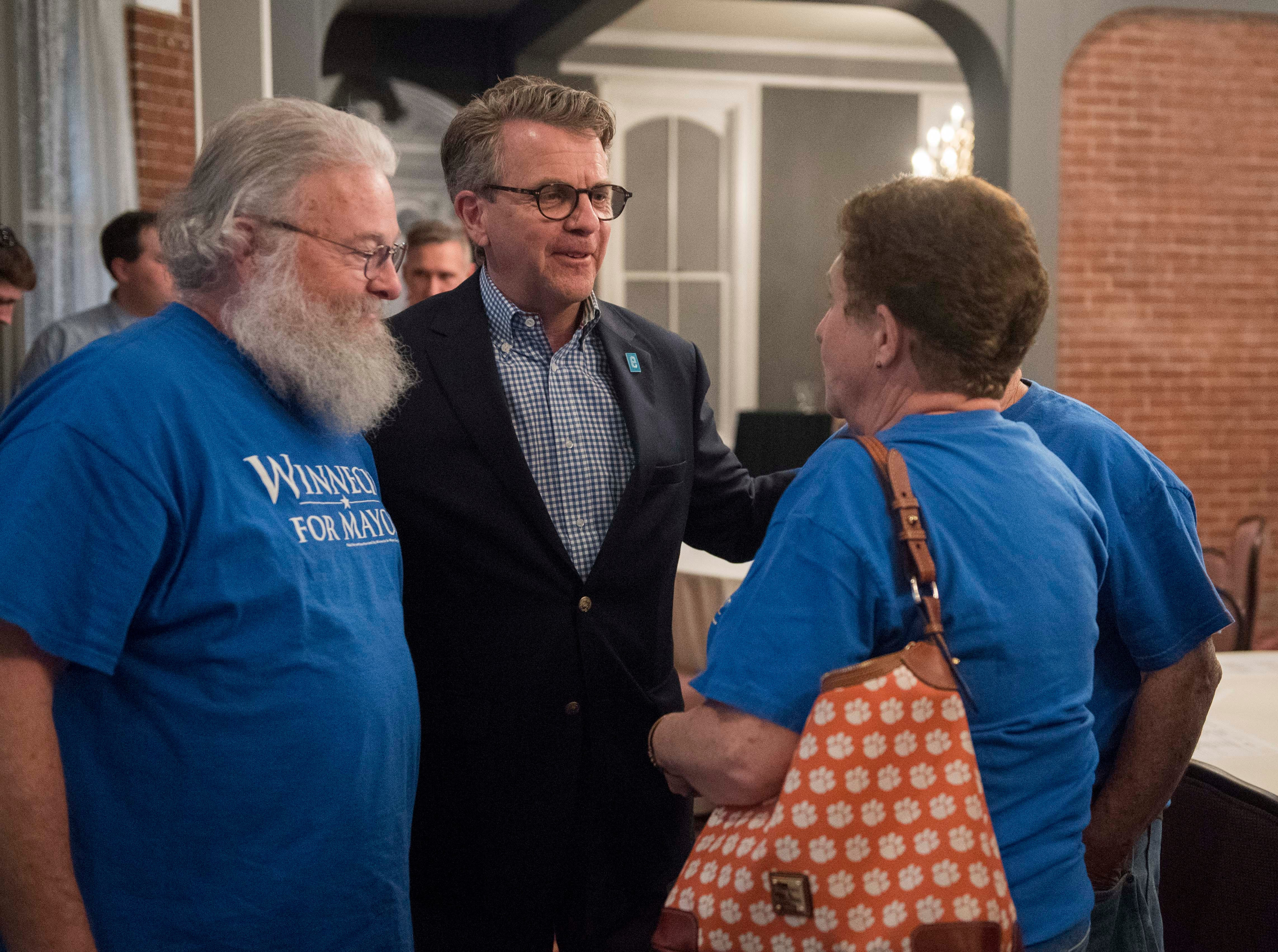 Mayor Lloyd Winnecke chats with supporter Susan Harp, Tuesday, May 7, 2019.