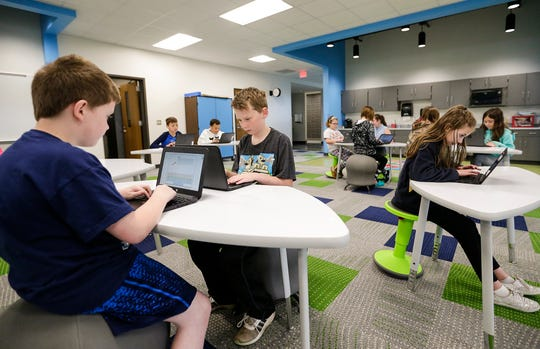 Johnathan Feltes, Preston Moon and Alayna Kartos work in an open study area adjacent to their classroom Tuesday, May 7, 2019 in the new addition of Friendship Learning Center in North Fond du Lac, Wis. Doug Raflik/USA TODAY NETWORK-Wisconsin