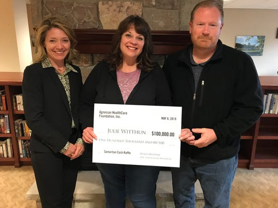 Holly Brenner, Agnesian HealthCare Foundation president, (left) is shown with Julie and Steve Witthun, of Waupun. Julie was drawn as the grand prize winner of this year's $100,000 Samaritan Cash Raffle.