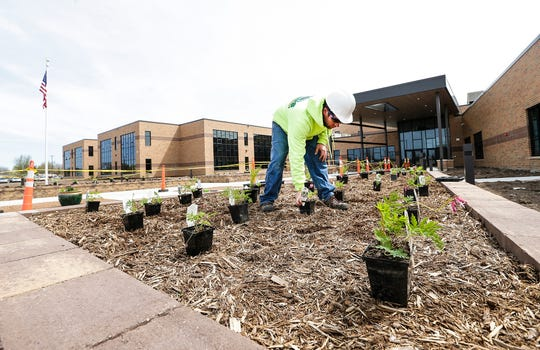 Ryan Kissel of Stuart's Landscaping gets plantings ready Tuesday, May 7, 2019 in front of the new addition of Friendship Learning Center in North Fond du Lac, Wis. Doug Raflik/USA TODAY NETWORK-Wisconsin