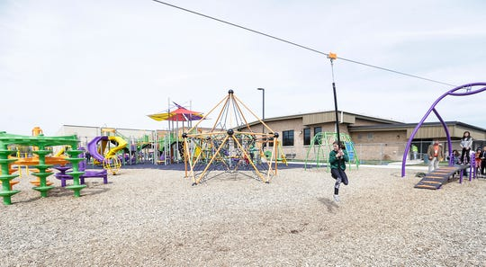 Sophia Tjader rides the zipline Tuesday, May 7, 2019 on the playground of the new addition to Friendship Learning Center in North Fond du Lac, Wis. Doug Raflik/USA TODAY NETWORK-Wisconsin