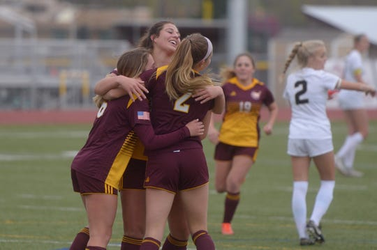 Windsor girls soccer players celebrate the first goal of a 4-2 first-round Class 5A playoff win over Monarch on Tuesday, May 7, 2019.