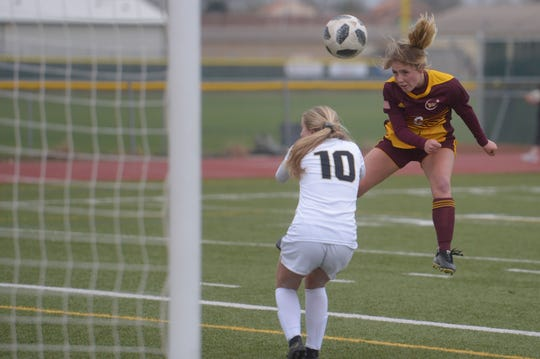 Windsor soccer player Domonique Webb heads in the opening goal of the Wizards' 4-2 Class 5A first-round playoff win over Monarch on Tuesday, May 7, 2019.