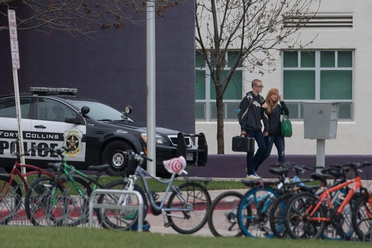 A parent walks a student out the front entrance of Preston Middle School after the school was taken off the secured lockout status initiated after an unsubstantiated threat was received via the Safe2tell tip line on Wednesday, May 8, 2019, at Preston Middle School in Fort Collins, Colo.