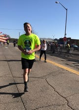 Paramedics, EMTs and firefighters performed CPR on Kyle Woods, 24, for 12 minutes after he went into cardiac arrest at the end of the Colorado Half-Marathon.