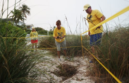 Turtle Time volunteers, Rae Ann Hanly and Bill Heavner document a loggerhead sea turtle nest on Bonita Beach on Wednesday May, 8, 2019. It is the beginning of nesting season for sea turtles.