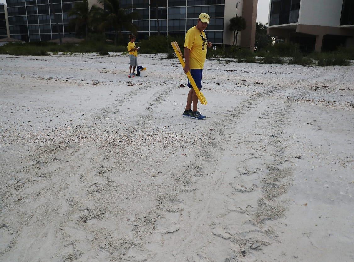 Turtle Time volunteer Bill Heavner documents a loggerhead sea turtle false crawl on Bonita Beach on Wednesday May, 8, 2019. It is the beginning of nesting season for sea turtles.