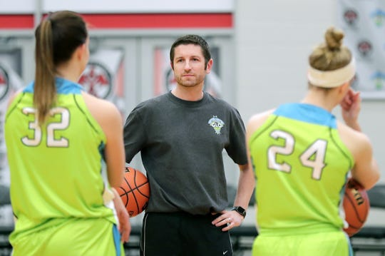 Coach Dan Carey talks to players during a Wisconsin Glo practice Tuesday at Menominee Nation Arena in Oshkosh.