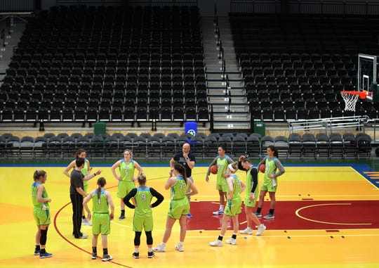 Wisconsin Glo players practice Tuesday at Menominee Nation Arena in Oshkosh. The professional women's basketball team begins play Friday.