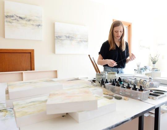 Taylor Adams works in her studio on Lake Keowee. Adams is one of Artisphere's 2019 Emerging Festival Artists.