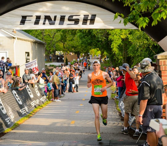 Thousands of runners, walkers and spectators participate in the 10th annual GHS Swamp Rabbit 5K at Gateway Park in Travelers Rest. The event has a festival feel with live music and food. DAVID GROOMS/Contributor