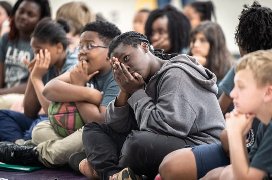 Kendall Chery, a 5th grade student at Lead Academy in Greenville, reacts to medical images of surgery shown by Dr. Cedrek McFadden, a colorectal surgeon with Prisma Health as he and other doctors speak to students about their professions, Wednesday, May 8, 2019.