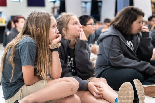Sophia Corso and Marisa Furner, 6th grade students at Lead Academy in Greenville, listen as doctors from Prisma Health speak to them about their professions Wednesday, May 8, 2019.