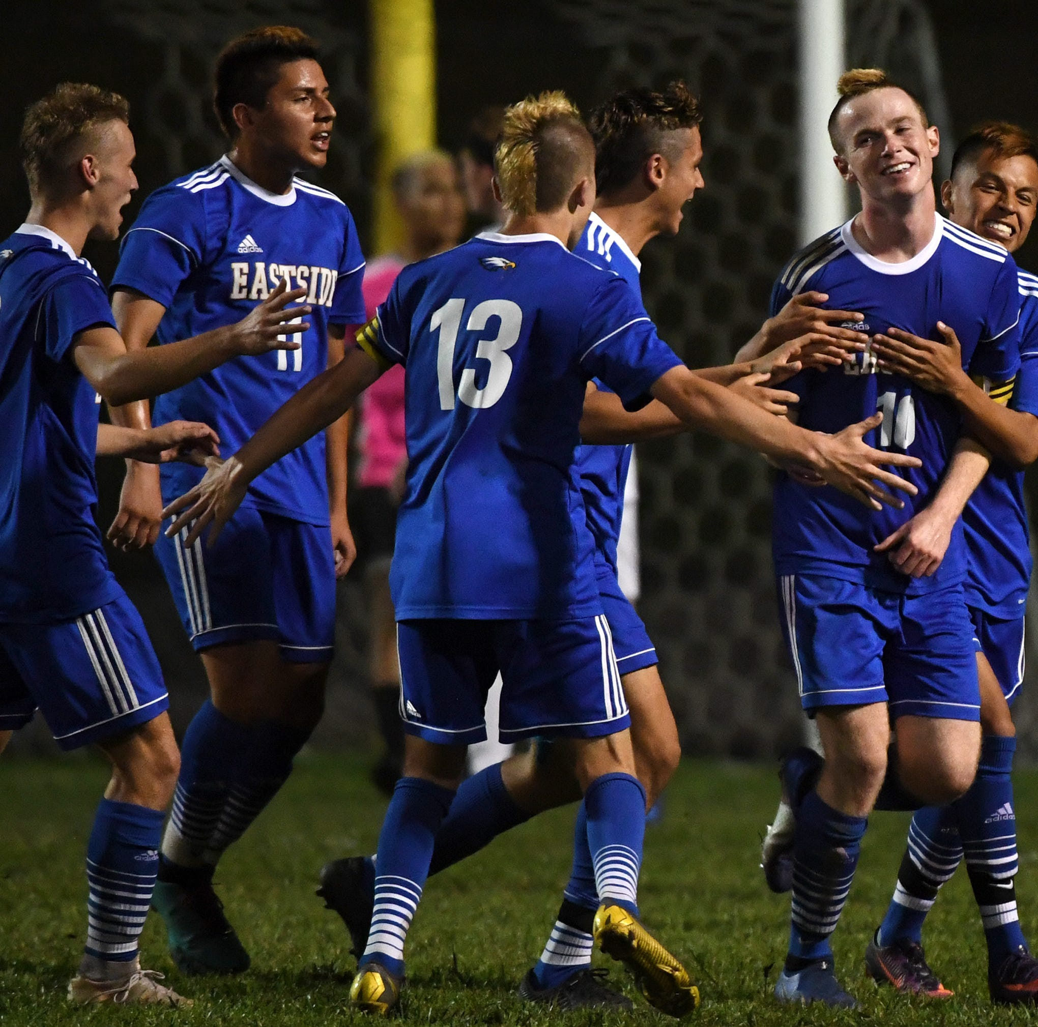 The Eastside High School soccer team celebrate Will Brandenburg's (10) goal in overtime during the game against Wren High School at Eastside High School Tuesday, May 7, 2019.