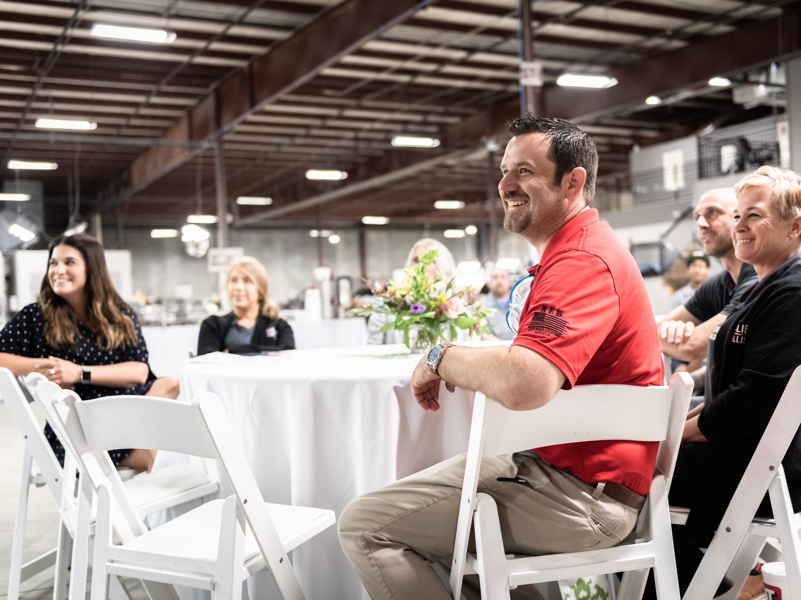 Workers at Caliber Collision on Ridge Road in Greenville, gather for a ceremony Wednesday, May 8, 2019, at which Leah Floyd, 23, a single mother of Anderson, is presented with a 2018 Chevy Cruze as part of their Recycled Rides program. Caliber Collision partners with Geico for the program and worked with local nonprofit, AIM who nominated Floyd as the recipient.