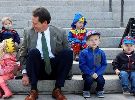 Gov. Steve Bullock sits with children at a ?Rally for Montana?s Future Superheroes? in support of publicly funded early childhood education.  Photo courtesy state of Montana