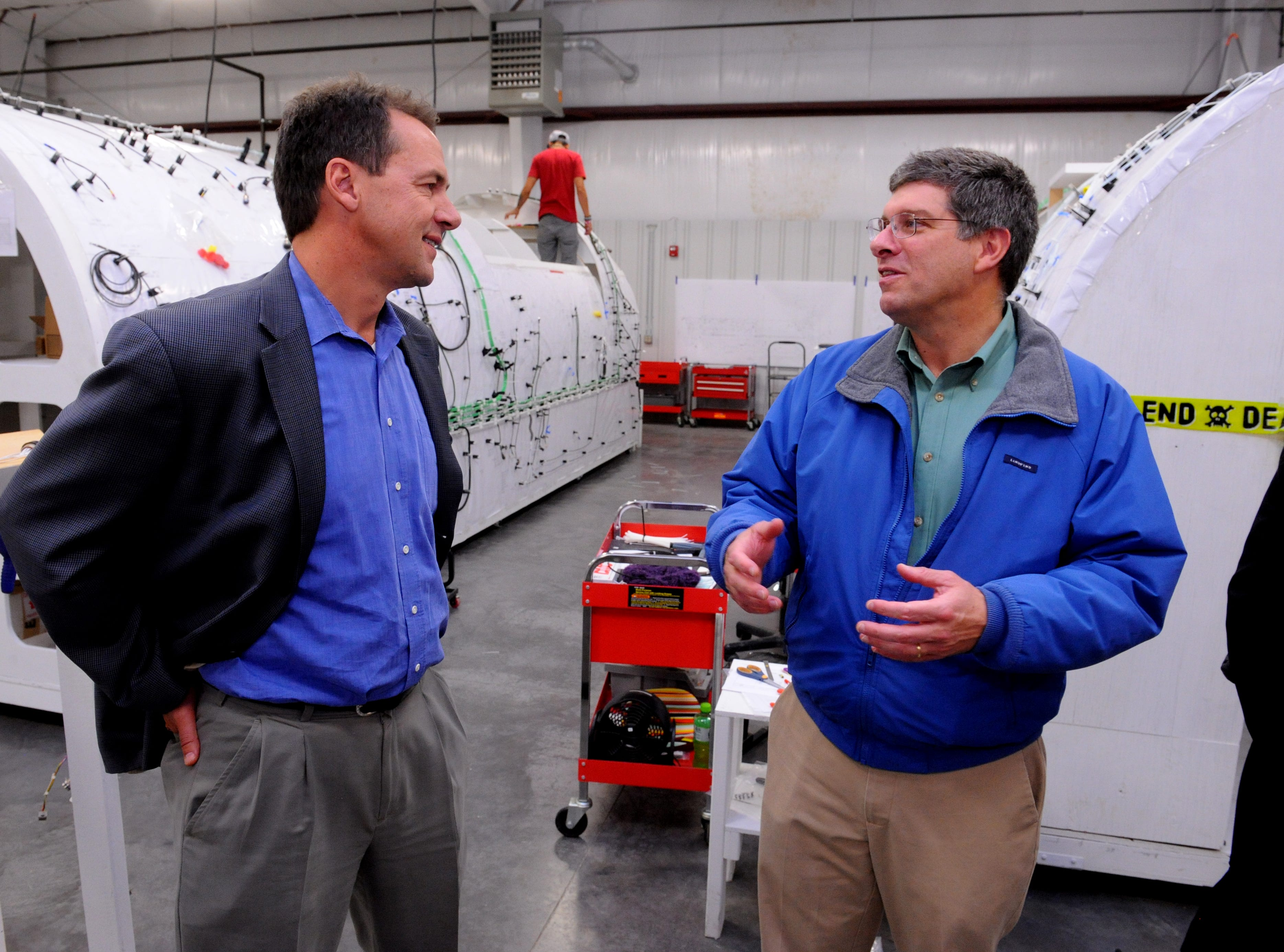 Montana Gov. Steve Bullock, left, talks with Brett Doney of the Great Falls Development Authority while touring the EMTEQ manufacturing warehouse. Last year, EMTEQ was awarded $255,000 in workforce training grant money from the state. TRIBUNE PHOTO FILE/RION SANDERS Montana gubernatorial candidate Steve Bullock, left, talks with Brett Doney of the Great Falls Devolpment Authority while touring the EMTEQ manufacturing warehouse while campaigning in Great Falls on Friday. TRIBUNE PHOTO/RION SANDERS